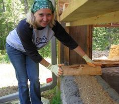 "The technique involves laying two beads of  mortar, followed by filing the insulation cavity in the middle (here it is filled with sawdust mixed with lime).  Then the cordwood is set in the mortar beads.  This provides an insulation R-value of 1.5 per inch of wall.  A 16"" cordwood wall has an R-value of 24."