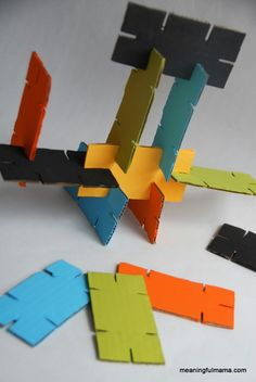 Cardboard Stackers - Easy Upcycled Craft for kids - Meaningful Mama   Great for fine motor skills and bilateral coordination!