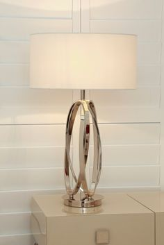 Infinite loops create the Oval table lamp, fabulous style for any setting!