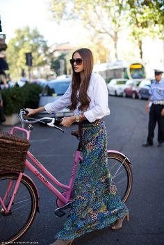 I'd imagine it would be difficult to ride in this skirt, but at least she looks fabulous..