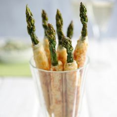 Asparagus Cigars - This is an easy vegetarian canapé recipe for your Christmas meal. Best vegetarian canapes recipes | Drinks party recipes - Red Online. For the full recipe, visit www.redonline.co.uk