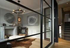 Buster-and-Punch---The-Mews-House-2 Internal Glass dividing wall. Good idea for the glazing as you come through front door