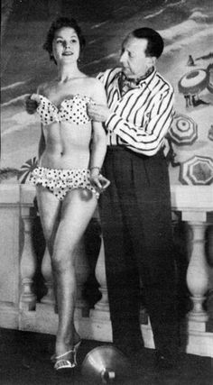 "Louis Reard, inventor of the bikini, with model in The idea of a suit ""smaller than the world's smallest bathing suit"" struck him when he saw women rolling up their beachwear to get a better tan. He named his creation ""bikini"" after the Bikini Atoll. Moda Fashion, 1940s Fashion, Vintage Fashion, Fashion Models, Paris Fashion, Fashion Fashion, Old Photos, Vintage Photos, Jacques Heim"