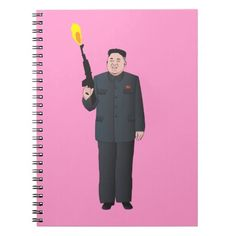 Laughing Kim Jong-un firing a gun into the air Spiral Note Books.  #kimjongun #northkorea #korea #laughing #zazzle #knappidesign