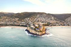 Laguna Beach aerial. Irvine Cove on the left, Emerald Bay on the right. Shot from a Robinson 44 helicopter.