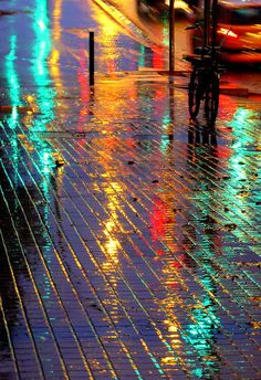 So colorful and shiny. I love the touch of the dark bicycle among all the beauty. The contrast is striking. :-)