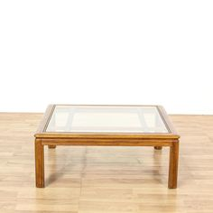 """This """"Drexel"""" coffee table is featured in a solid wood with a glossy maple finish. This coffee table has carved trim, straight legs and a large square glass table top. Perfect for a spacious living room! #americantraditional #tables #coffeetable #sandiegovintage #vintagefurniture"""