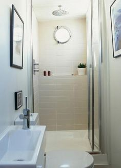 TINY bathroom with porthole and IKEA Lillangen sink and vanity. GREAT use of space!
