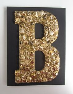 Wooden Letter with Gold Buttons