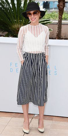 The Best and Boldest Looks from the Cannes Red Carpet! | PARKER POSEY | in a stripe see-through top with a coordinating A-line skirt, teamed with a bucket hat (do we spot a new hair color under there?) and oversize shades at a photocall for Irrational Man.