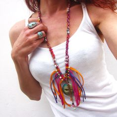 In a true blast of vibrant colors, this bohemian leather fringe & gemstone statement necklace will turn heads! This gorgeous necklace features a