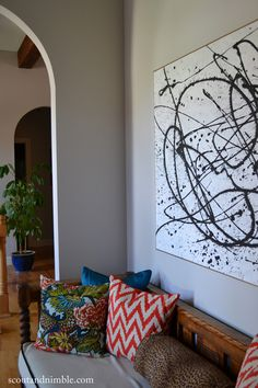 See how Missouri blogger Jessie Bodine at Scout and Nimble did a West Elm hack and created her own black and white abstract art with paint, a drop cloth and wood scraps!