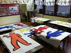 "Elementary - kids trace each other and they paint/cut out huge keith haring poses, then assemble to create a ""mural"" for cafeteria!"