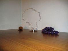 profile of a woman MATERIALS: hanger, hard drive components DIMENSIONS: 33x24 cm http://www.facebook.com/artefizio