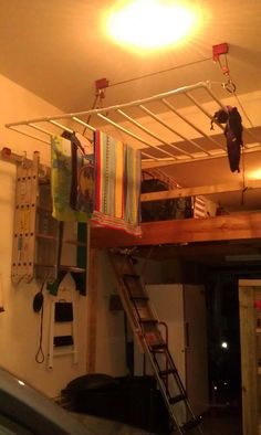 We built a drying rack out of pvc pipe and mounted it in our garage.  We needed something to do with the wet pool towels, occasional wet snow stuff, and for airing out camping gear.  The outer sides of the rack have rebar in it for stability.  The rack is mounted on a pulley system so that we can lower it to hang stuff and raise it up so it's out of the way.