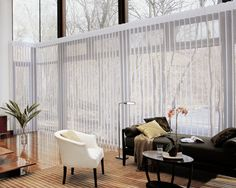 I love tall blinds like this! It is able to let in so much light, and then close it when they are shut. I would love to have big windows like this in my home, so I could have as much natural lighting as this room does!