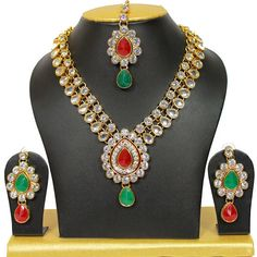 Wedding Wear Dazzling Indian Bollywood Red & Green Stone Women Necklace Set #natural_gems15 Kundan Jewellery Set, Indian Jewelry Sets, Women's Jewelry Sets, Wedding Jewelry Sets, Bridal Jewelry, Women Jewelry, Bollywood Wedding, Indian Bollywood, Bollywood Style