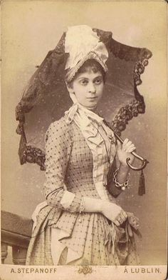 Carte de visite,1880s | Perfectly accessorized for a weekend walk! I also like that her bracelets are mis-matched. Up until the 1880s (and even past then) bracelets were almost always worn in pairs. The thick chain is beautiful!