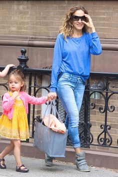 Jean Queens: Sarah Jessica Parker is cool and casual in head-to-toe blue. She updates the laid-back look with these fitted Level 99 Janice skinny jeans in the light, airy Cirrus wash, paired with her trendy Koolaburra Preston wedge sneakers.