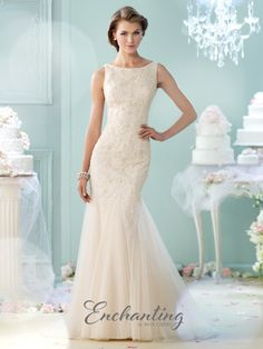 Sleeveless hand-beaded tulle trumpet gown, bateau neckline, crisscross back, sweep train. Available in Stone or Ivory