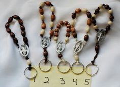 One Decade Rosary Keychains by AllToolsPrayerful on Etsy.  Great for stocking stuffers.  Numbers 2 & 4 have sold, 1,3, and 5 still available.
