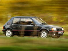 As the Peugeot 205 celebrates its Birthday, we take a look back at the history of the light-footed hatchback Peugeot 205 Gti, 205 Turbo 16, Volkswagen, Bmw, Car Photography, Old Cars, Cars And Motorcycles, Pugs, Race Cars
