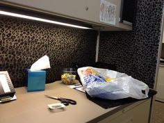 Cubicle wallpaper! Bought fabric from Hobby Lobby and pinned it to the cubicle walls. Easy Peasy