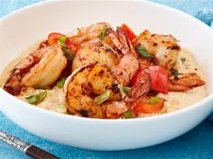 Calories: 224  Yes, it's true – we give you cheesy grits topped with flavorful red pepper shrimp for less than 250 calories!   See the complete Skillet-Grilled Red Pepper Shrimp recipe