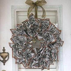 Use cocktail napkins and an old grapevine wreath to create this simple and beautiful holiday decor. The theme of this wreath can be easily changed by simply using different cocktail napkins. Make one for any occasion.