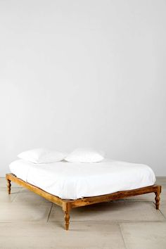 A neat Asian/Euro/Bohemian design crossover   (Magical Thinking Bohemian Platform Bed at Urban Outfitters)