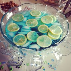 Boy baby shower punch ! Blue kool-aid with 7up and Oranges instead of lemons