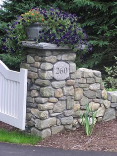 Stone entryway...I love how the picket fence meets the stones.