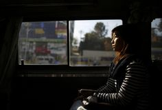 A woman rides a women-only bus in Kathmandu, January 6, 2015. Nepal's capital Kathmandu has introduced women-only buses in an attempt to reduce sexual harassment and groping on public transport. The initiative will start with four 16-seater buses which will ply a popular east-west route across the city during peak morning and evening hours. REUTERS/Navesh Chitrakar