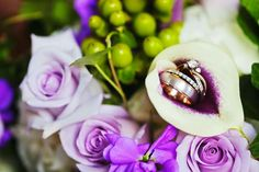 Our rings in my bouquet. Cala lilies. Ocean song roses. Green berries. White hydrangeas. Purple stock. And ivy to make it pop.