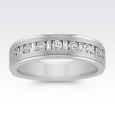 This classy 14 karat white gold band is part of our Unity collection and is designed to complement a narrow style band, sold separately.  Six round diamonds, at approximately .35 carat TW, and five baguette diamonds, at approximately .15 carat TW, sparkle and shine in a channel setting.  Hand-matched for maximum brilliance and sparkle, the total gem weight is approximately .50 carat.
