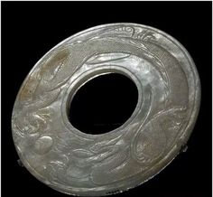 Jade disc with dragon motif, Tang Dynasty. Collection of Shanghai Museum, China