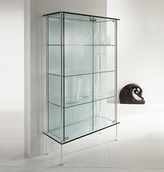 Furniture Elegant Design Of Modern Display Armoire Made Using Gles Material With Invisible Sy Thin Framework