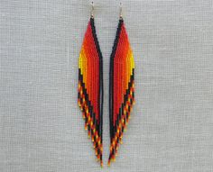 Extra Long Earrings. Native American Earrings Inspired. Red Yellow Black Orange Earrings. Shoulder Dusters. Wings.Beadwork.. $31,00, via Etsy.
