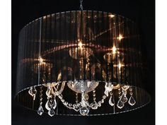 This glasswork pendant light has three bulbs and is surrounded with a cylindrical fabric shade.