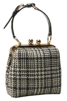 "<p>Wool Tweed Sicily Bag, $1,745; <a href=""http://www.dolcegabbana.com/"" target=""_blank"">dolcegabbana.com</a></p>"