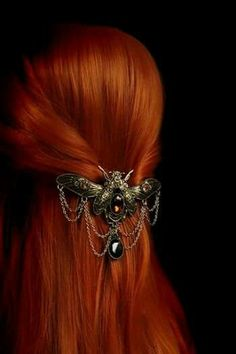 Beautiful red hair pulled together with a badass gothic barrette