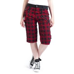 The girls shorts of EMP Black Premium wear a black-red checkered pattern. They're knee-length and have removable straps on the sides. The black waist is in contrast to the colour of the trousers.