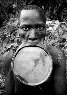 Surma woman with giant lip plate - Kibish Ethiopia by Eric Lafforgue, via Flickr