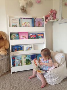 Hands up if like this little kid you fancy sitting down in your comfy chair surrounded by your favorite books #bookcase #reading #kids