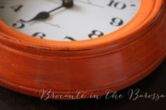 A Blend of Barcelona Orange and Primer Red custom color finish on a timber framed wall clock, using Chalk Paint® decorative paint by Annie Sloan.  Brocante in the Barossa