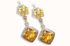 18 KARAT WHITE GOLD FACETED CITRINE CUSHION-CUT DROP EARRINGS.