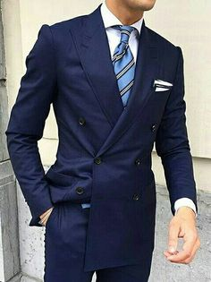 Dark blue double breasted suit,  lite blue tie.  This is a nice outfit!