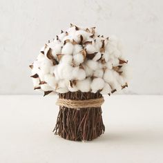"""A twine-tied bundle of natural twigs forms the base for this bouquet of soft, dried cotton pods.- Dried cotton pods, foam base, twine, twigs- Indoor use only- For best longevity, avoid direct sunlight and moisture- Natural materials; slight variance in color or shape may occur- Imported10.25""""H, 8.8"""" diameter, 3.2"""" diameter base"""