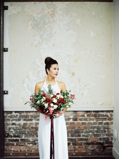 Classic simple bridal dress and rhinestone crawler earrings. #wedding #jewelry