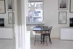 Homevialaura | Modern White kitchen | Kartell Gé | Eames DSR | Ton Chair 14 | Anno Paperitähti from Kodin1 | gallery wall